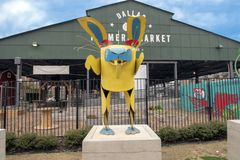 Dallas Farmers Market with whimsical rabbit, one of six metal sculptures, Dallas, Texas. Pictured is a whimsical rabbit, one of six metal sculptures in front of stock photo