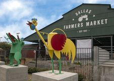 Dallas Farmers Market with whimsical rooster and frog, two of six metal sculptures, Dallas, Texas. Pictured is a whimsical rooster and frog, two of six metal royalty free stock images