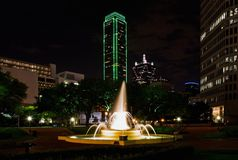 Dallas at Night. Fountain in small park with tall office buildings in background in Dallas, Texas Royalty Free Stock Photos