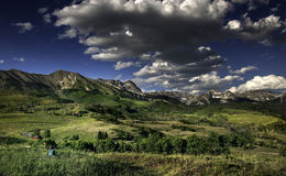 The Dallas Range of the San Juan Mountains Near Telluride, Colorado. A glorious Rocky Mountains afternoon spreads before us in a stunning panorama where land and Stock Photo
