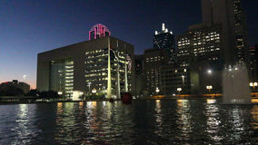 Dallas Skyline: Nightly Light reflections in water stock video footage