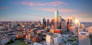 Dallas, Texas cityscape with blue sky at sunset. In USA stock images