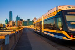 DALLAS, TEXAS - DECEMBER 10, 2017 -  Moving streetcar on the Houston Street Viaduct with the city of Dallas in background. The Dal. DALLAS, TEXAS - DECEMBER 10 Royalty Free Stock Images