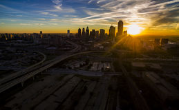 Dallas Texas Skyline Downtown Cityscape Sunrise sun rays over Urban Prawl massive City Stock Images
