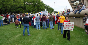 Dallas Texas Tea Party. DALLAS - APRIL 15: Taken in Dallas, Texas in front of City Hall on US Tax Day April 15, 2009. A crowd gathers to protest big government Royalty Free Stock Images
