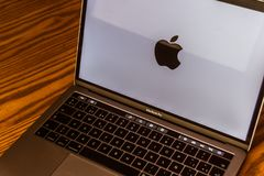 Apple logo on laptop screen. Dallas, Texas/ United States - 06/7/2018: Photograph of the Apple logo on computer screen Royalty Free Stock Photos