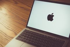 Apple logo on laptop screen. Dallas, Texas/ United States - 06/7/2018: Photograph of the Apple logo on computer screen stock photography