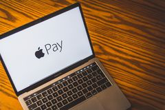 Apple pay logo on computer screen. Dallas, Texas/ United States - 06/7/2018: Photograph of the Apple pay logo on computer screen stock photo
