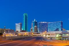 DALLAS, TX - DECEMBER 10, 2017 - Downtown Dallas skyline at night with illuminated glass buildings seen from Houston Street royalty free stock photo