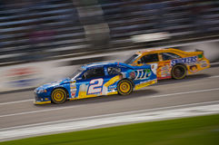 DALLAS, TX - NOVEMBER 04: Brad Keselowski 2 passes Kyle Busch 18 Royalty Free Stock Images