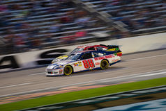 DALLAS, TX - NOVEMBER 04: Dale Earnhardt Jr passing Clint Boyer stock images