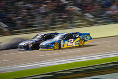 DALLAS, TX - NOVEMBER 04: Jimmie Johnson 48 passing Brad Keselow Stock Photos