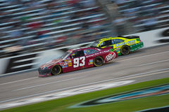DALLAS, TX - NOVEMBER 04: Travis Kvapil passes Paul Menard 27 at Royalty Free Stock Photography