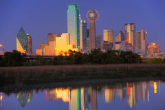 Dallas, TX Skyline at Dusk. Dallas, with a population of 1,279,910, is the third-largest city in Texas and the 8th-largest in the United States stock photos