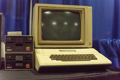 Old Apple II computer system at event exhibition. DALLAS, TX, USA-APR 26, 2019: Apple II computer with foam-molded plastic case. It was the first consumer stock images