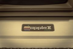 Filtered image close-up logo of old Apple II computer. DALLAS, TX, USA-APR 26, 2019:Vintage tone close-up Apple II logo on foam-molded plastic case. It was the stock photography