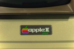 Filtered image close-up logo of old Apple II computer. DALLAS, TX, USA-APR 26, 2019:Vintage tone close-up Apple II logo on foam-molded plastic case. It was the stock photo