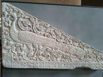 Dalle de marbre avec le paon Image stock