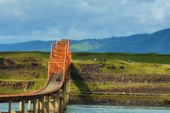 The Dalles Bridge in the Columbia River Gorge. The Dalles Bridge seen and photographed from car traveling on I-84 through the Columbia River Gorge in Oregon stock image