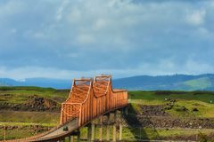 The Dalles Bridge in the Columbia River Gorge. The Dalles Bridge seen and photographed from car traveling on I-84 through the Columbia River Gorge in Oregon stock images
