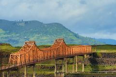 The Dalles Bridge in the Columbia River Gorge. The Dalles Bridge seen and photographed from car traveling on I-84 through the Columbia River Gorge in Oregon Royalty Free Stock Image