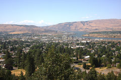 The Dalles Oregon. The city of the Dalles in NE Oregon state, beyond the hills Mt. Adams in Washington state is also visible Royalty Free Stock Image