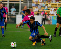 Dallman and Chang collide. USL Soccer. Royalty Free Stock Image