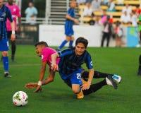 Dallman and Chang collide. USL Soccer. Royalty Free Stock Photos