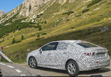 Dalmatian car at Passo Pordoi Stock Photos