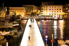 Dalmatian city of Zadar harbor bridge. Dalmatian city of Zadar harbor pedestrian bridge at night Stock Image