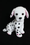 A Dalmatian dog toy with black spots for decoration Royalty Free Stock Images
