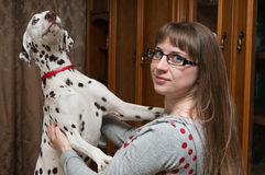 Dalmatian and girl Stock Images