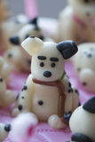Dalmatian puppy made of marzipan with sausages in a teeth Royalty Free Stock Image