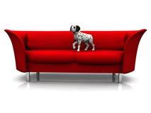 Dalmatian puppy in sofa. A cute dalmatian puppy in a red sofa Stock Images
