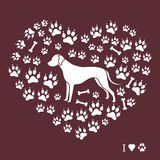 Dalmatian silhouette on a background of dog tracks and bones in. The form of heart. Design element for postcard, banner, poster or print Stock Photos