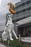Dalmation Balancing a Taxi on its Nose in New York. An image of a Dalmation Balancing a Taxi on its Nose statue create by artist Donald Lipski in New York stock photography