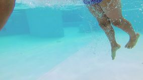 Dalmine, Italy August 18, 2018: Outdoor swimming pool. The teenager swims in the pool under the water. Dalmine, Italy August 18, 2018: Outdoor swimming pool stock footage