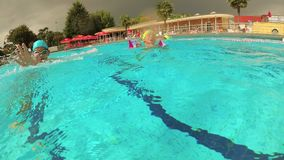 Dalmine, Italy August 18, 2018: Outdoor swimming pool. The teenager swims in the pool under the water. Dalmine, Italy August 18, 2018: Outdoor swimming pool stock video footage