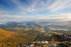 Dalsikt på soluppgång uppifrån av bergen, toppig bergskedja Salvada Royaltyfri Bild