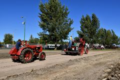 Advance steam engine pulling a McCormick W30 tractor. DALTON, MINNESOTA, Sept 8, 2017: An old Advance steam engine pulls a McCormick Deering W 30 at the annual Royalty Free Stock Photo