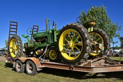 John Deere General Purpose tractor on flatbed trailer,. DALTON, MINNESOTA, Sept 8, 2017: A restored John Deere General Purpose tractor on a flat bed trailer will stock photography