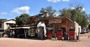 Outback Servo petrol station and souvenir shack with helicopter on the roof in Daly. Daly Waters, Australia - Jun 13, 2018. `Outback Servo` petrol station and stock photography