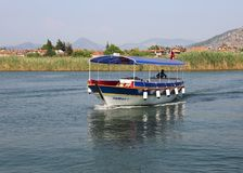 Tour Boats traveling to Iztuzu beach pick up his customers Royalty Free Stock Images