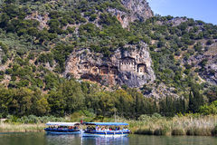 The Dalyan River with tourist boats in the straits of the river Stock Photo