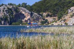 The Dalyan River with tourist boats in the straits of the river Royalty Free Stock Photography
