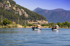 The Dalyan River with tourist boats in the straits of the river Stock Photos