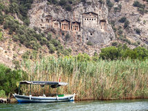 The Dalyan River under Lycian tombs Stock Photo