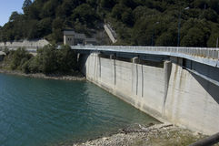 Dam. A dam photografed in the Abruzzo mountains stock photo
