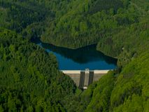 The dam. Aerial photo of dam in between mountains. Krimov - Czech Republic Stock Photography