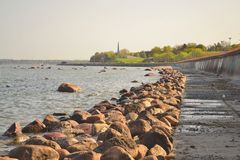 Dam along sea coast. Royalty Free Stock Photo